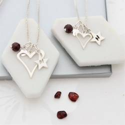 mother and daughter open heart necklaces with garnet birthstone for january