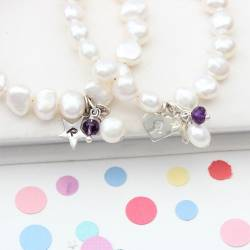 childs personalised white pearl and amethyst gemstone birthstone and silver charm christening bracelet for february birthday