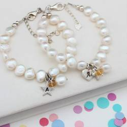 childs personalised white pearl and citrine gemstone birthstone and silver charm christening bracelet for november birthday