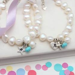 childs personalised white pearl and turquoise gemstone birthstone and silver charm christening bracelet for december birthday