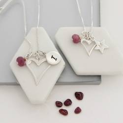 mother and daughter open heart necklaces with ruby birthstone for july