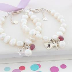 childs personalised white pearl and ruby gemstone birthstone and silver charm christening bracelet for july birthday