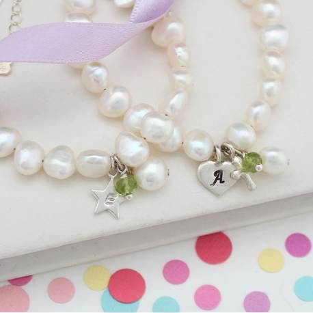 childs personalised white pearl and peridot gemstone birthstone and silver charm christening bracelet for august birthday