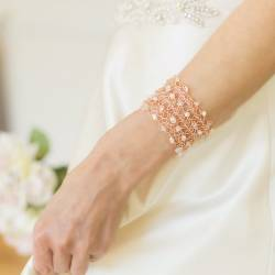 Filigree Cuff Bracelets in rose gold with pearl, moonstone and crystal being worn