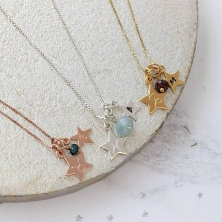 Capricorn, Pisces and Taurus zodiac star charm necklace with garnet, aquamarine and emerald birthstones in silver, gold and rose