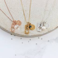 aries, taurus and gemini zodiac disc tag charm necklace in silver, rose gold and gold with with crystal, emerald and pearl