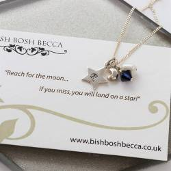 reach for the moon good luck silver charm necklace personalised with her initial