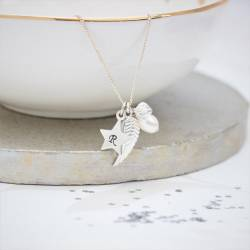 silver angel wing and star necklace personalised with her initial a gift to wish her good luck