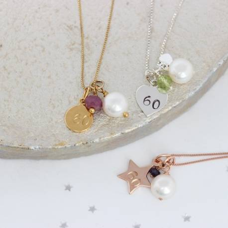 60th birthday charm necklaces with ruby (July) peridot (August) and Sapphire (September)