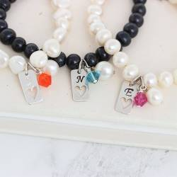 personalised pearl bracelet with silver tag charm with heart and crystal in living coral, teal and fushcia pink