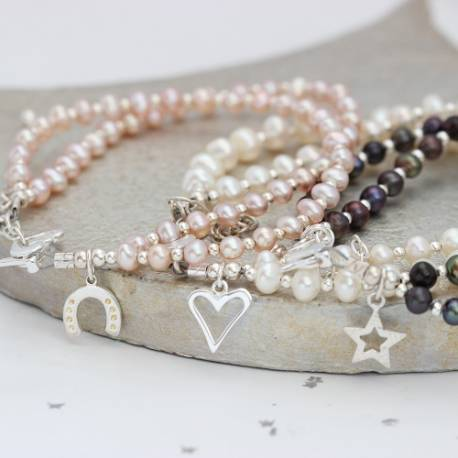 personalised double pearl bracelet in pink, white or peacock with silver charm by Bish Bosh Becca