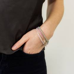 Crystal friendship stacking bracelets in bright pink or blue and pastel mauve and white