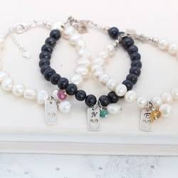 bridesmaids personalised pearl bracelets with tag charm and birthstone gemstones for May, July and November