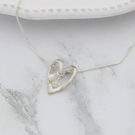 nerissa silver twisted heart wedding necklace with a white pearl and crystal, jewellery for a bride or her bridemaids