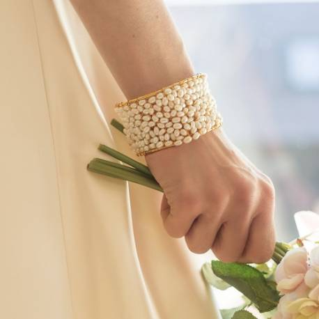 bridal white pearl crochet cuff on frame, a silver or gold statement bracelet for a modern bride