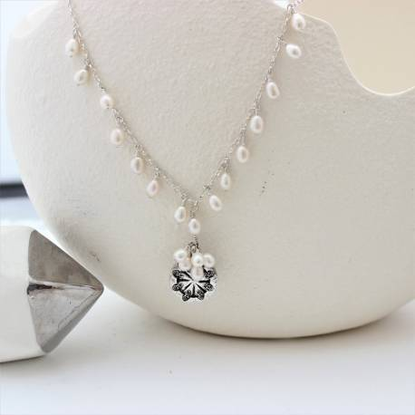 silver coin and white pearl wedding necklace on silver chain boho chic for a beach bride
