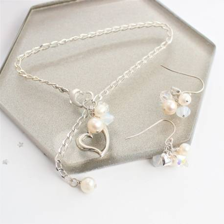 silver open heart bracelet and drop earrings in bridal white, delicate pearl and swarovski crystal jewellery for a bride