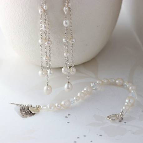 luna white pearl wedding jewellery set with mismatched bracelet and dangle earrings for a bride