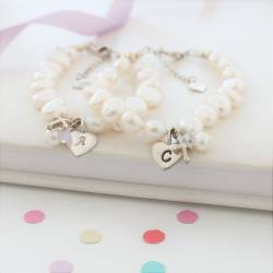 treasured childs white pearl christening bracelet personalised with her initial on a silver charm