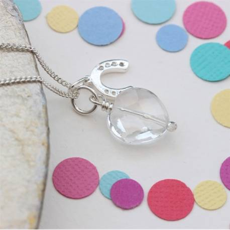 childs faceted crystal heart necklace with sterling silver horsehoe charm for good luck