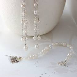 luna handmade pearl bracelet and dangle necklace and earrings in white for a bride on her wedding day