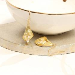 gold plated cala lily drop earring with pearl stamen on fish hooks, nature inspired jewellery gift ideas