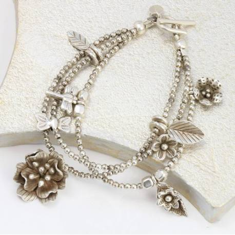 keimau sterling silver handmade multi layered stack bracelet with flower and leaf charms