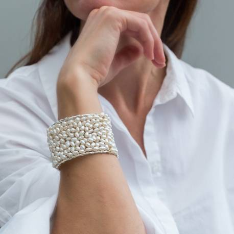 handmade statement cuff bracelets in gold or silver with white pearls, dramatic modern jewellery gifts for her