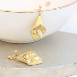 gold plated cala lily drop earring with pearl stamen on studs, nature inspired jewellery gift ideas for her