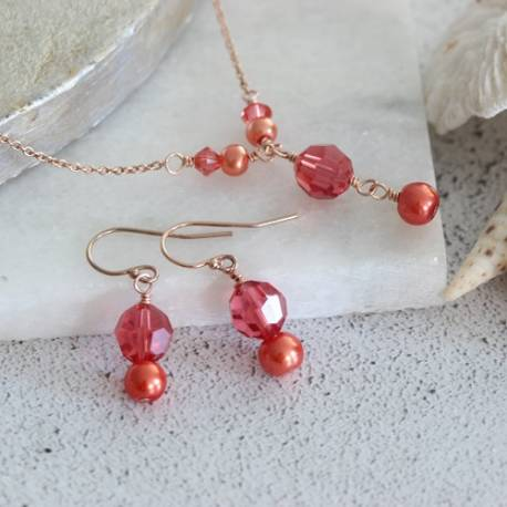 handmade affordable cassio swarovski pearl and crystal necklace and earrings set in living coral on rose gold