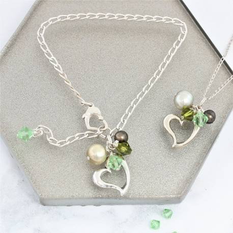 silver heart jewellery gift set, necklace and matching bracelet with green pearls and swarovski crystals