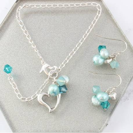 silver heart jewellery set, bracelet and matching drop earrings with turquoise pearls and swarovski crystals