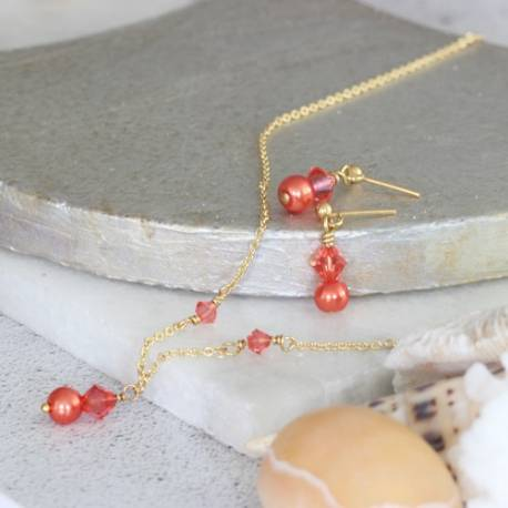imogen swarovski pearl and crystal necklace and earrings set in living coral on gold, delicate jewellery for summer