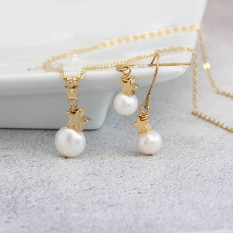 white pearl pendant with gold star and matching drop earrings , pearl jewellery set for her