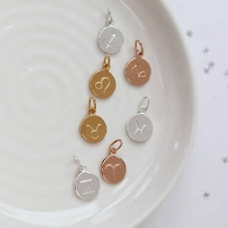 zodiac disc charms in sterling silver, rose gold and gold, in every star sign to create a personalised gift for her