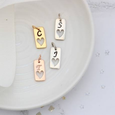 initial letter tag charm in silver, rose gold or gold personalised in every letter of the alphabet for birthday gifts