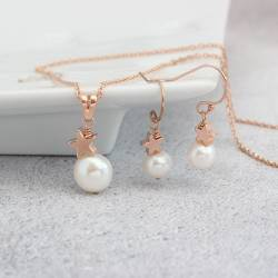 white pearl pendant with rose gold star and matching earrings, delicate bridal jewellery for a winter wedding