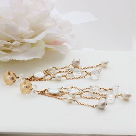 extra long pearl and crystal dangle wedding earrings on a gold disc stud, dramatic jewellery for a modern bride