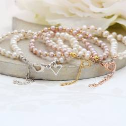 double strand white pearl wedding bracelet with gold clasp. Dainty wedding jewellery for a bride and her bridesmaids