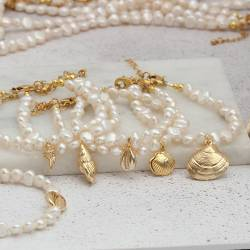 gold plated seashell charm and white pearl bracelets