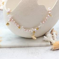 pink pearl statement necklace with natural quartz gemstone and gold plated seashell charms