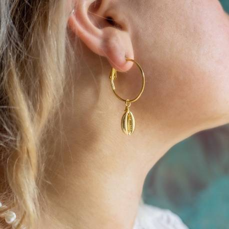 gold plated cowrie shell charms on hoop earrings