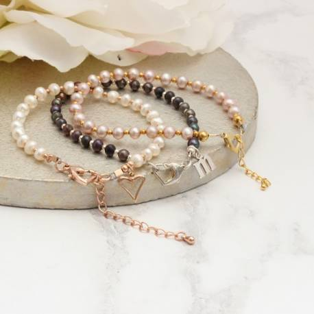 delicate pearl stacking friendship bracelets handmade by Bish Bosh Becca, add a charm for a treasured gift for her
