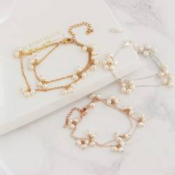 double stranded bridal white layered pearl wedding bracelet on rose gold, delicate pearl jewellery for a bride