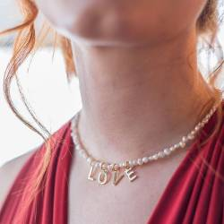pearl choker necklace with word charms for joy, wow, star, luck, love, peace, smile, happy