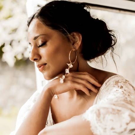 lily flower and pearl bridal hoop earrings with rose gold chain for a bride on her wedding day