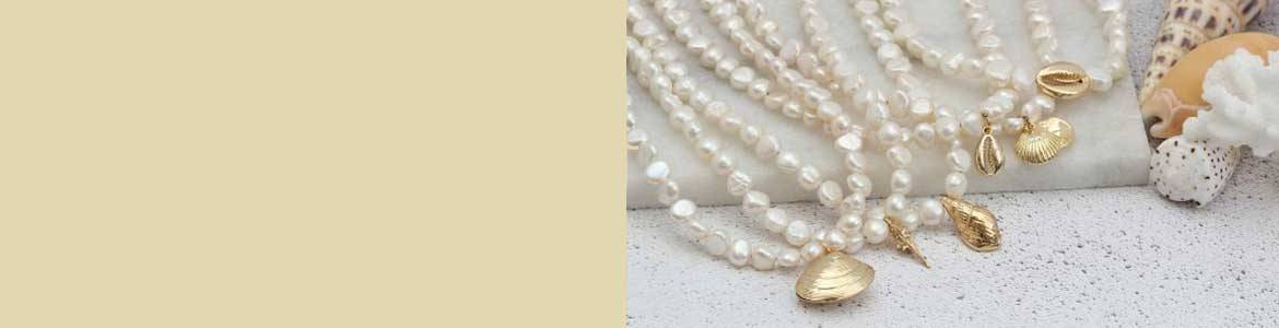 Shop seashell and summer jewellery, find colourful gemstone or pearl necklaces, bracelets and earrings
